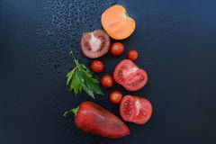 Vegetables. Tomatoes, cherry tomatoes, red pepper and lovage Royalty Free Stock Photo