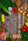 Vegetables and Tomatoes on Cutting Board Stock Image