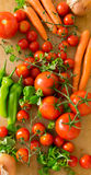 Vegetables - tomatoes, onion, carrots and pepperoni Stock Photos