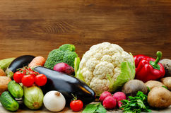 Vegetables. tomatoes, potatoes, eggplant, zucchini, onion, carro. Vegetables on a wood background. the toning. selective focus Royalty Free Stock Photos