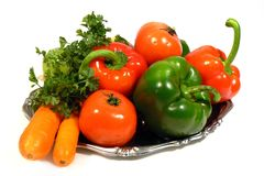 Vegetables on tray isolated. Vegetables and some fruit on tray isolated on white Stock Image