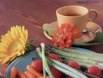 Vegetables on a Turquoise plate with flowers Royalty Free Stock Images
