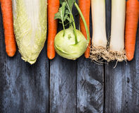 Vegetables various for cooking: leek,Kolrabi,cabbage and carrots on blue wooden background, top view Royalty Free Stock Image