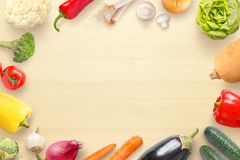Vegetables view from above on kitchen table with copy space in the middle Royalty Free Stock Photos