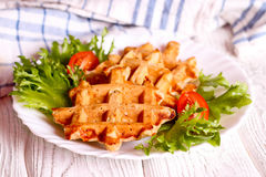 Vegetables waffles on a white plate Stock Photo