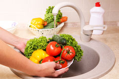 Vegetables washing in a kitchen. Stock Photography