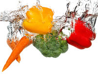 Vegetables in water splash. Isolated on white background Stock Photos