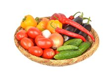 Vegetables in a wattled basket Stock Images