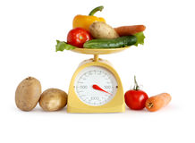 Vegetables On Weight Scale Royalty Free Stock Photography