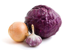 Vegetables on white background. Red heads of cabbage,  bulb of yellow  onion and garlic isolated on white background Stock Photo