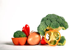 Vegetables on a white background  broccoli  peppers Stock Photos
