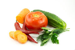 Vegetables on a white background. Carrot, pepper, tomato, cucumber, parsley and dill isolated on white background Royalty Free Stock Image