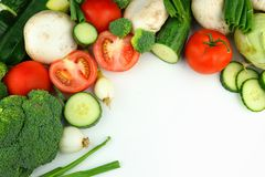 Vegetables on the white background tomato, brocoli, cucumber onion, champignon, zucchini. Vegetables on the white background: tomato, brocoli, cucumber onion royalty free stock photos