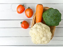 Vegetables on white wooden table. Tomato,carrot,broccoli and cauliflower vegetables on white wooden table for healthy food concept with copy space Stock Images