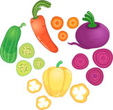 Vegetables whole and sliced into pieces Royalty Free Stock Photo