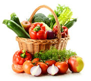 Vegetables in wicker basket Stock Images