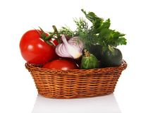 Vegetables in wicker basket royalty free stock image