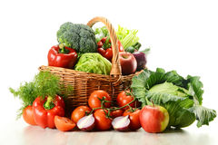 Vegetables in wicker basket isolated on white Stock Photos