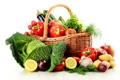 Vegetables and wicker basket isolated on white Stock Photo