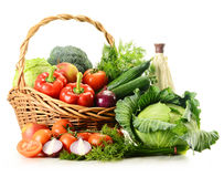 Vegetables in wicker basket isolated on white Royalty Free Stock Photos