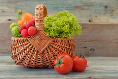 Vegetables in the wicker basket Stock Images