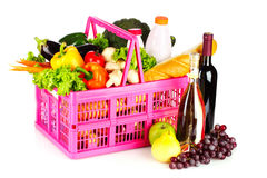Vegetables and wine in a basket isolated Stock Photos