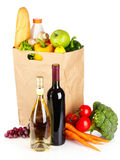 Vegetables and wine in a paper bag stock photography