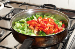 Vegetables in a wok pan Stock Images