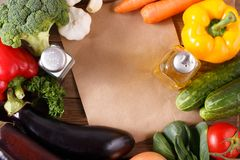 Vegetables on wood background with space for recipe. Royalty Free Stock Photo