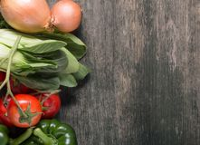 Vegetables on wood background with space for text. Organic food. Royalty Free Stock Photography