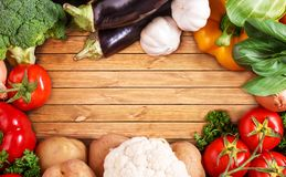 Vegetables on wood background with space for text. Organic food. Stock Images