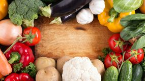 Vegetables on wood background with space for text. Organic food. Royalty Free Stock Images