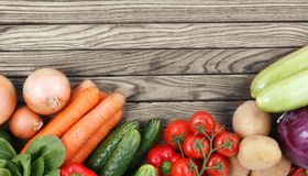Vegetables on wood background with space for text. Stock Image