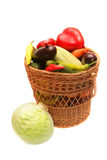 Vegetables in woven basket. Stock Photo