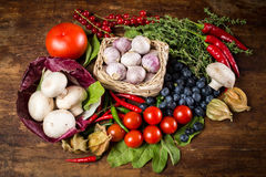 Vegetables on wood. Bio Healthy food, herbs and spices. Organic vegetables on wood Royalty Free Stock Photo