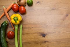 Vegetables on wood. Bio Healthy food, herbs and spices. Organic vegetables on wood. Close-up royalty free stock photos