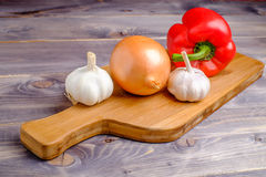 Vegetables on the wood desk. Vegetables on the wood  old fashioned desk Royalty Free Stock Image