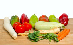 Vegetables on a wooden background Stock Photo