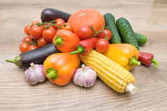 Vegetables on a wooden background close up Stock Photos