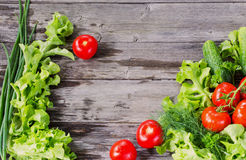 Vegetables on a wooden background Royalty Free Stock Image