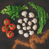 Vegetables on the wooden background. Raw vegetables are laid out on a wooden table Royalty Free Stock Photo