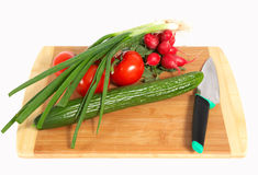 Vegetables on wooden board Stock Image