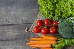 Vegetables on wooden board Stock Photo