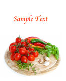 Vegetables on wooden board and example text. Vegetables on wooden board on white background royalty free stock photography