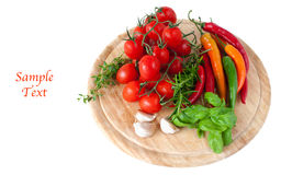 Vegetables on wooden board and example text. Vegetables on wooden board on white background stock image