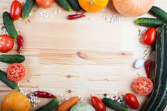 Vegetables on a wooden board. Fresh vegetables lying on a wooden board Royalty Free Stock Photography