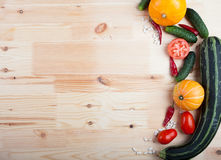 Vegetables on a wooden board. Fresh vegetables lying on a wooden board Stock Photo