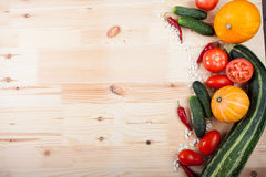 Vegetables on a wooden board. Fresh vegetables lying on a wooden board Royalty Free Stock Photo