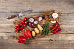 Vegetables on wooden board stock images