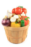 Vegetables in wooden bushel basket. Still picture of different vegetables and ingredients - pepper, potatoes, tomatoes, garlic, onion, mushrooms, Jalapeno in stock photography